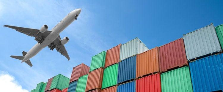 plane-over-cargo-ship